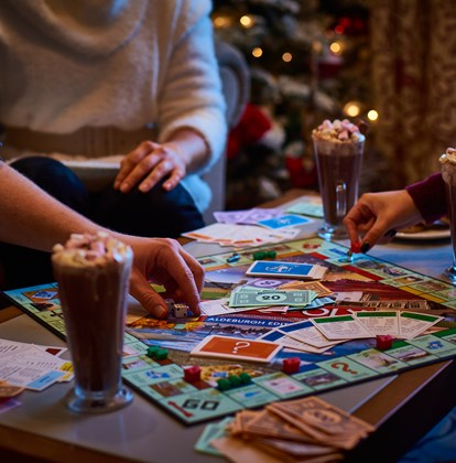 White Lion Folk playing board games with hot chocolate in lounge